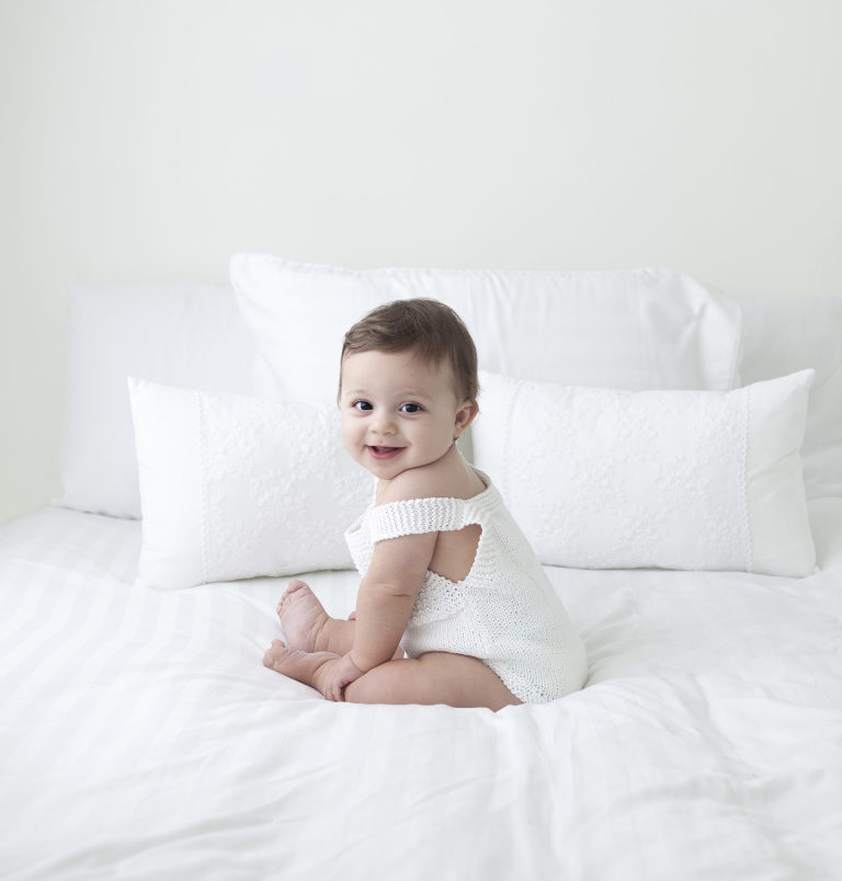 older baby sat on bed gallery