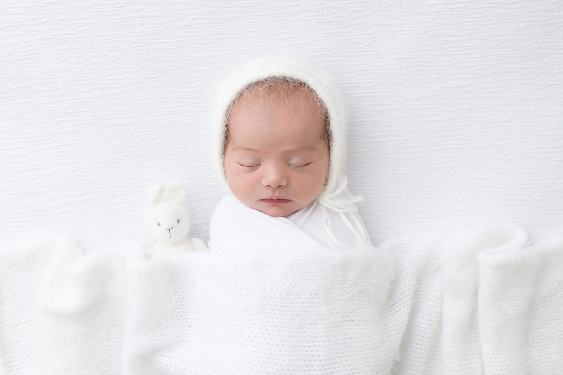 newborn photographer in a white wrap